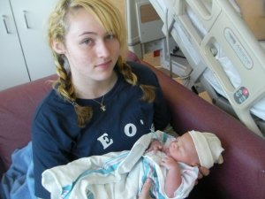 Kayla, age 16, holding her little brother Leo. This photo is from February 2009. The next baby Kayla holds will be her own.